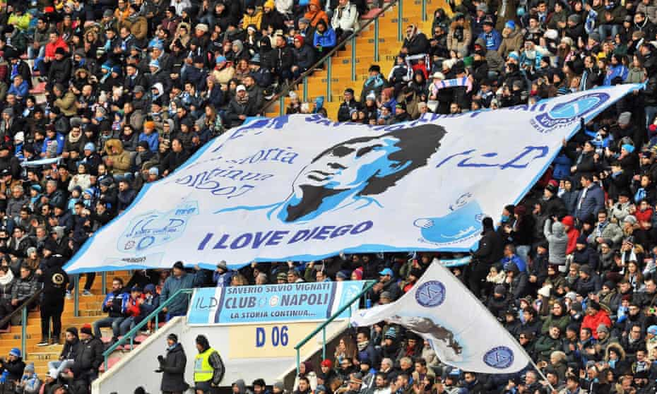 Enduring love: Napoli fans with a banner of Maradona in 2017.