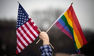 Lgbt Protest At Stonewall Inn Takes On Edge Amid Possible Blow To  A Protesters Waves A Rainbow Flag And An American Flat At The Womens March  On Washington