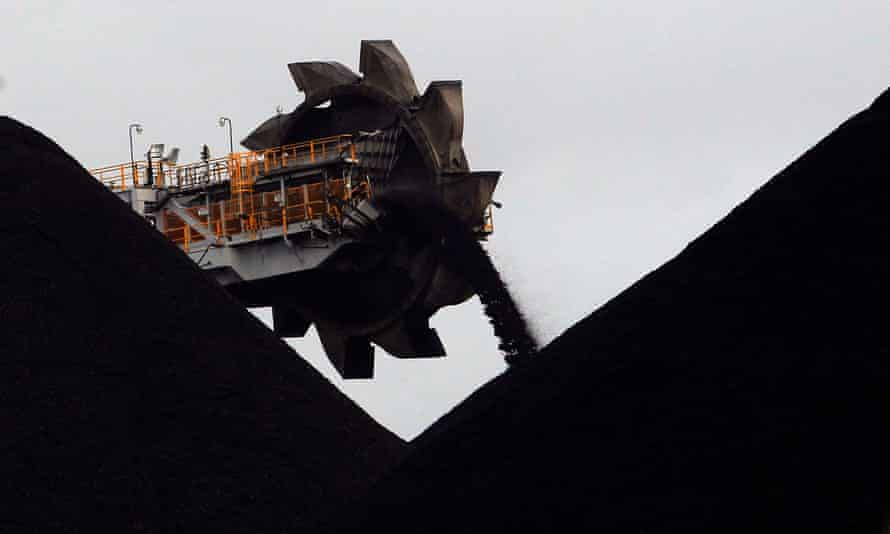 A reclaimer places coal in stockpiles at the coal port in Newcastle.