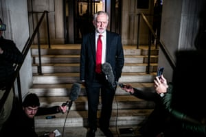 Jeremy Corbyn walks down steps