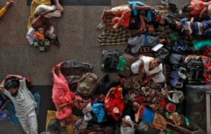 New Delhi, India: Passengers wait for their train at the railway station