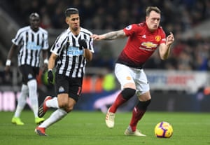 Phil Jones of Manchester United is challenged by Ayoze Perez of Newcastle United