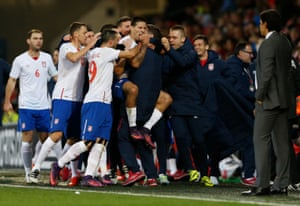 Chris Coleman looks on as Serbia's Aleksandar Mitrovic celebrates his goal.