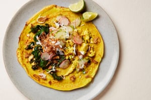 Yotam Ottolenghi's turmeric pancakes with coronation chicken, paneer greens and condiments.