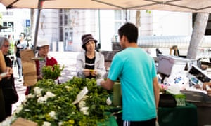Yan Qiong Chen, center, buys produce from the Heart of the City farmers' market in San Francisco with her SNAP benefits.