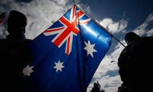 Men waving Australian flag