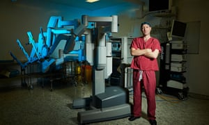Urologist Greg Shaw with the £1.5m machine which helps the UCH team do 600 prostate operations a year.