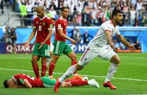 Bouhaddouz looks down as Iran's Mehdi Taremi celebrates.