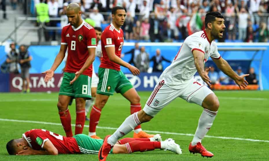 Iran's Mehdi Taremi celebrates after Morocco's Aziz Bouhaddouz's own goal.