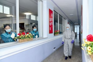 Pyongyang, North Korea. Employees at the Daesongsan mineral water factory disinfecting surfaces to prevent the spread of coronavirus
