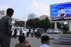 North Koreans in Pyongyang watch a news report on Friday about the nuclear test.