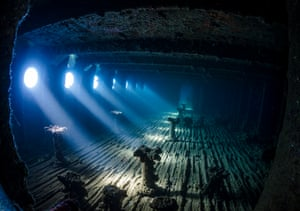 """Wrecks category – highly commended. The Haunted Room by Nadya Kulagina (Kazakhstan). Location: the Red Sea The stillness of this underwater scene flooded with light captured the judges' attention. It's """"what this room might have looked like when the Umbria was still intact and plying the seas"""", thought Kulagina. The wreck lies on its side so she flipped the camera vertically to get the shot."""