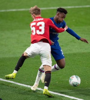 Brandon Williams of Manchester United grabs Callum Hudson-Odoi of Chelsea before throwing him to the over the advertising boards.