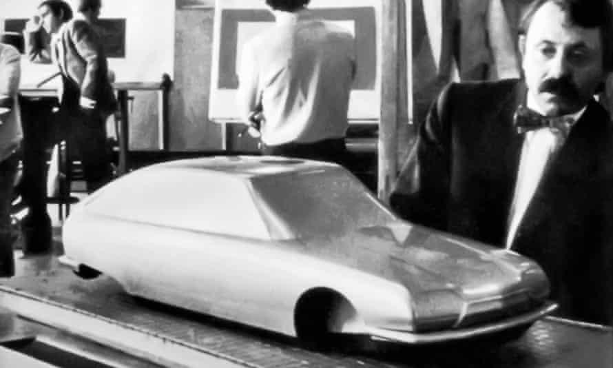 Robert Opron in 1965 examining a model of the Citroen GS he designed.
