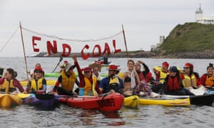 Anti-coal activists in kayaks and boats block the entrance to Newcastle harbour on Sunday.