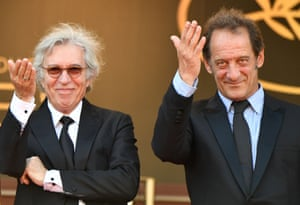 French director Jacques Doillon (L) and French actor Vincent Lindon gesture as they arrive for the screening of the film Rodin