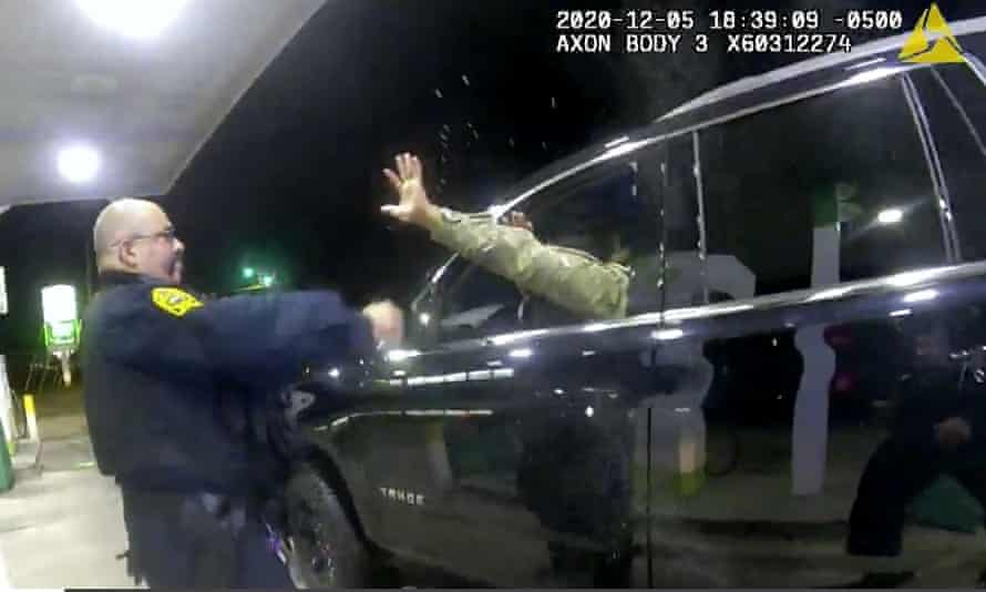 In this image made from Windsor police video, an officer uses a spray agent on Caron Nazario.