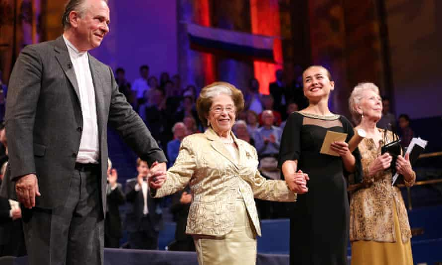 Dame Fanny Waterman, second from left, on stage with the winner of the 2015 Leeds International Piano Competition, Anna Tcybuleva and the conductor Sir Mark Elder.