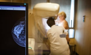 A woman and a medic during a mammogram screening