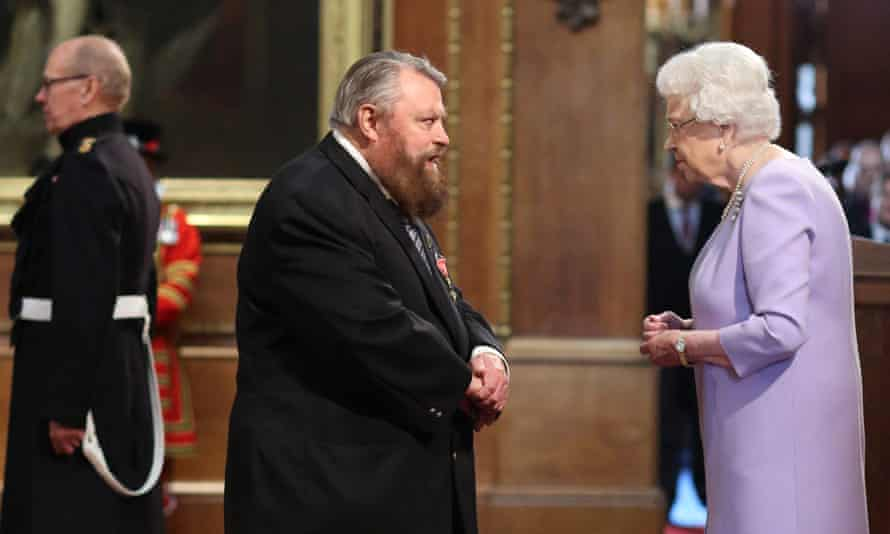 'Onward my brave Hawkmen!' … Brian Blessed  is made an OBE by the Queen in 2016.