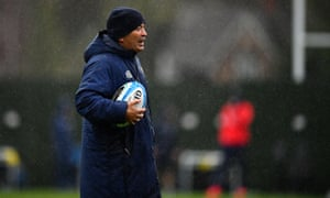 Eddie Jones watches an England training session in Teddington, in the leadup to their Six Nations match in Rome.