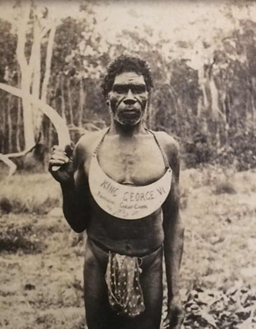 A photo of an Indigenous man with a 'king plate' around his neck