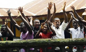 People celebrate being released from Ebola quarantine on 14 August 2015.
