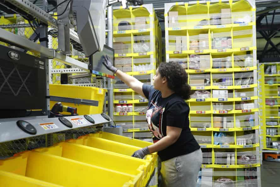A worker sorts through items and places orders at the Amazon fulfillment center on Staten Island.