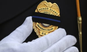 An officer wears black over his badge in honor of a colleague killed responding to a domestic dispute in Americas, Georgia on 11 December 2016.