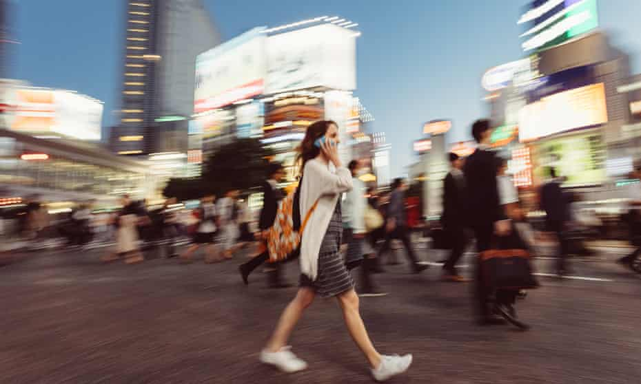 Woman on the phone at Shibuya crossing