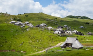 Green hills and cottages in Velika Planina, SloveniaHills on Velika Planina, Slovenia, summer time