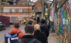 Queue outside Stour space polling station on Roach road in the constituency of Bethnal Green and Bow at 0815 on Thursday