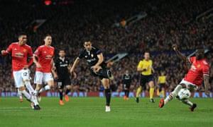 Wissam Ben Yedder of Sevilla scores at Old Trafford