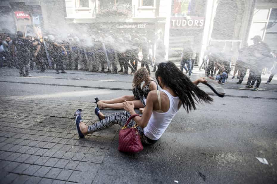 Riot police use a water cannon to disperse LGBT rights activist before a Gay Pride Parade in central Istanbul, Turkey.
