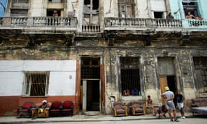 People put furniture out to dry outside their homes in Havana.