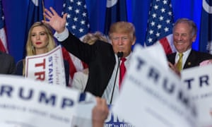 Donald Trump acknowledges cheering supporters celebrating his victory in the South Carolina Republican primary.