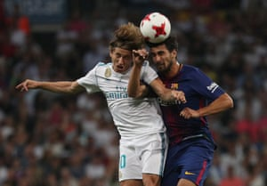 An aerial battle between Barcelona's Andre Gomes, right, and Real Madrid's Luka Modric.