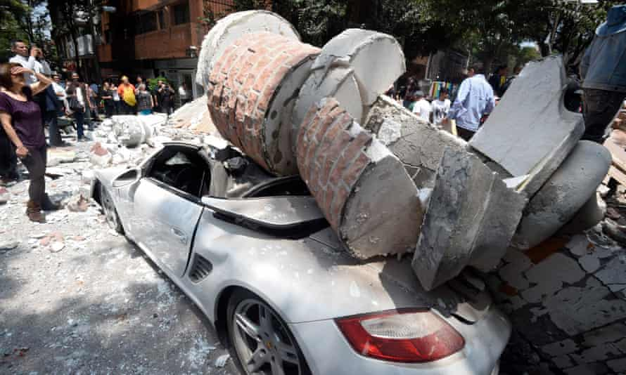 A car crushed by debris in Mexico City.