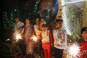People play with fireworks in Prayagraj, India