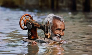 Tailor in Monsoon, Porbandar, from India by Steve McCurry