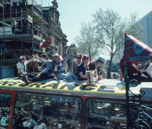 West Ham United players on top of the bus during the parade of the trophy around East London