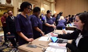 Bellagio hotel workers check in before caucusing at Bellagio Hotel in Las Vegas.