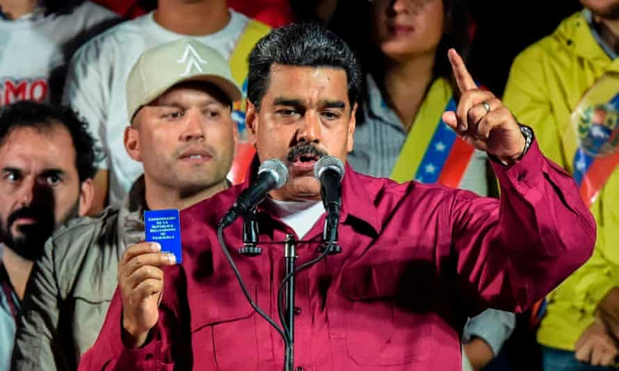 Maduro, seen here holding the political constitution, said: 'The revolution is here to stay.' But Boris Johnson says the G20 would 'be talking about what we can do'.