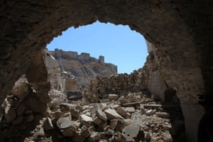 Aleppo's citadel is seen through destruction in the Farafira district