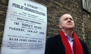 Ian Hislop stands in front of a poster from 1902 for a public demonstration to restrict immigration, inWho Should We Let in?