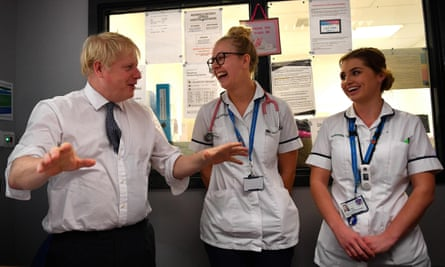 Boris Johnson meets nursing staff during a visit to King's Mill NHS Hospital in Mansfield, England.