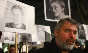 Dmitry Muratov, the editor of Novaya Gazeta, at a 2009 demonstration in Berlin with images of Russian journalists and activists who had been killed.