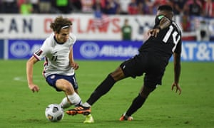 United States midfielder Brenden Aaronson (11) plays the ball past his marker.