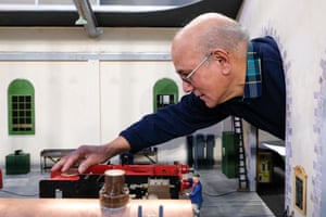 An engineer tinkers with his engine at a model engineering exhibition in London