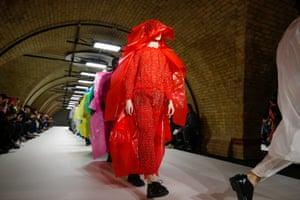Models present Craig Green creations down the catwalk at London men's fashion week